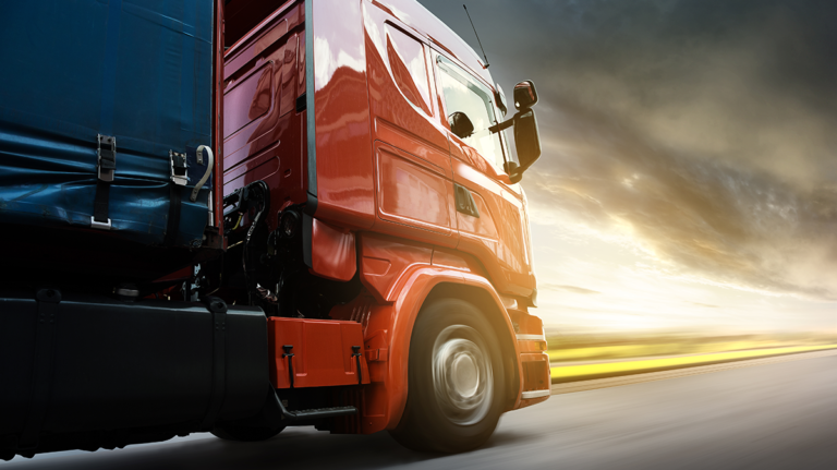 Czerwona ciężarówka Emka Logistic Olsztyn
